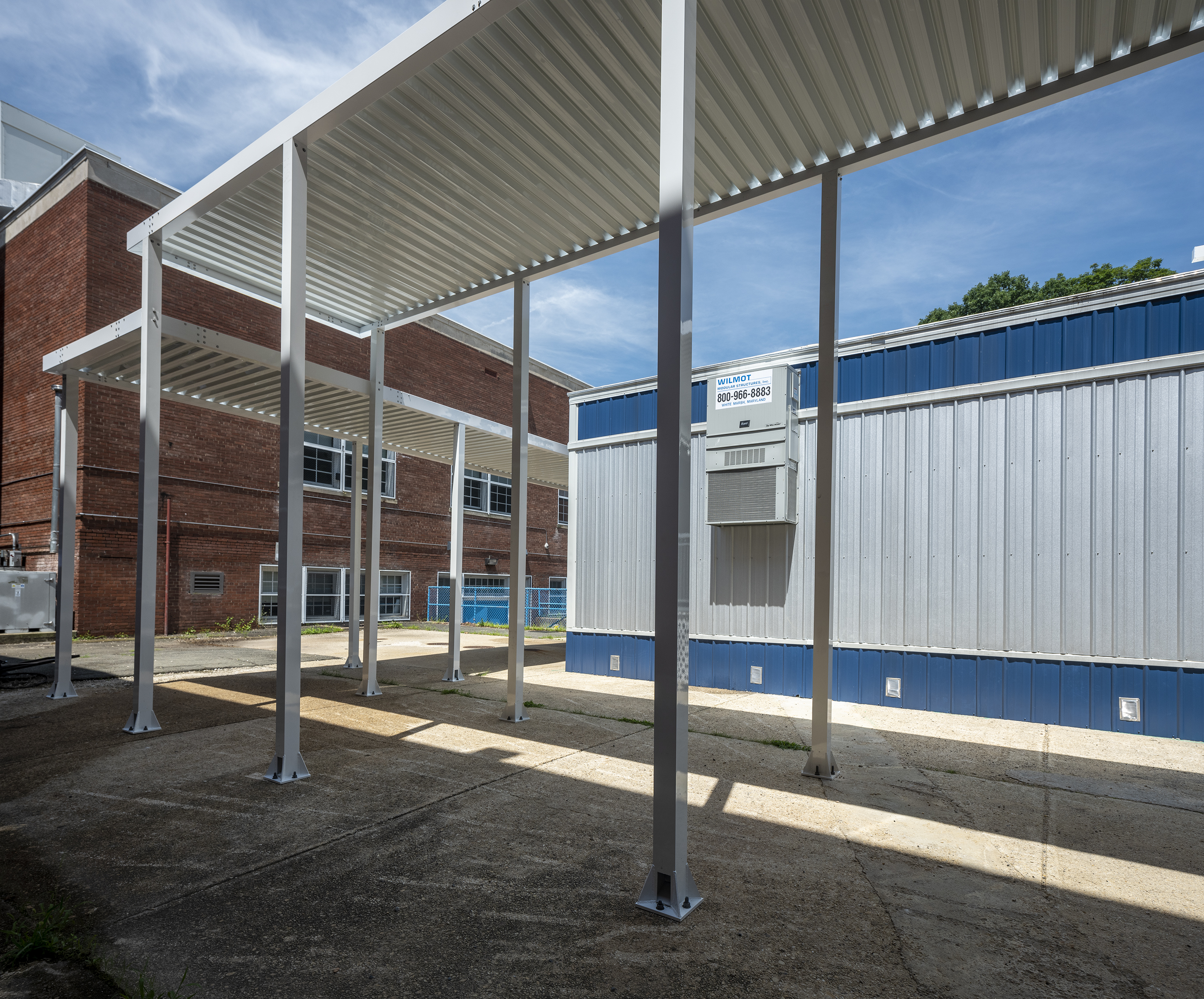 Canopies -over walkways for a modular structure